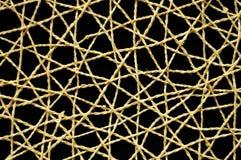 Rete di vimini tessuta con fondo nero Fotografia Stock Libera da Diritti