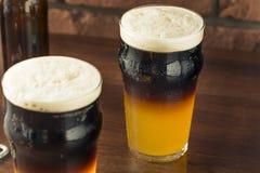 Il nero stratificato Irlandese e Tan Beer immagine stock libera da diritti