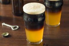 Il nero stratificato Irlandese e Tan Beer fotografie stock libere da diritti