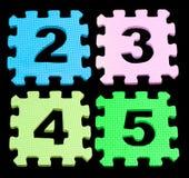Il numero che impara i blocchi ha isolato il nero Immagini Stock