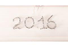 Il numero 2016 dei chiodi su un fondo di legno leggero Fotografia Stock Libera da Diritti