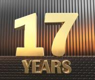 Il numero dorato diciassette numera 17 e gli anni di parola contro lo sfondo dei parallelepipedi rettangolari del metallo in Fotografia Stock