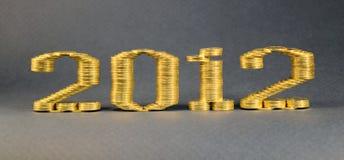 Il numero due mila dodicesimi ha posto le pile di monete Fotografia Stock Libera da Diritti