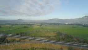 Il paesaggio tropicale con la strada principale, agricoltore sistema nelle Filippine Immagini Stock