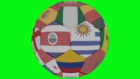 Il pallone da calcio a colori dei partecipanti della coppa del Mondo gira su un fondo trasparente verde, 3d rappresentazione, spi illustrazione di stock
