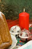 Il Pandoro - The traditional Italian Christmas c. Ake born in Verona, here together with a xmas candle and decorations Royalty Free Stock Images