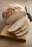 Il pane affetta la lama Fotografie Stock
