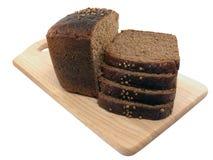 Il pane affetta la scheda di taglio di legno Immagine Stock Libera da Diritti