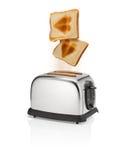 Il pane arrostito con il simbolo del cuore schiocca fuori dal tostapane Fotografia Stock Libera da Diritti