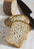 Il pane del grano è tagliato sui pezzi Fotografia Stock Libera da Diritti