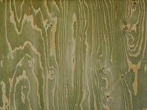 Il pannello di legno verdastro con le strisce ha creato dai nodi e dalle vene Fotografia Stock Libera da Diritti