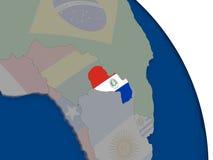 Il Paraguay con la bandiera sul globo Fotografia Stock Libera da Diritti