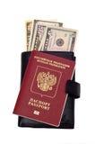Il passaporto, raccoglitore ed i dollari Fotografia Stock
