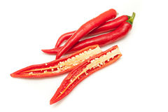 Il peperoncino rosso rosso prepara per la cottura sul fondo bianco isolato Fotografia Stock Libera da Diritti