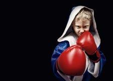 Il pericolo che guarda poco combattente di pugilato Fotografia Stock