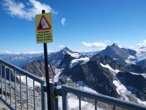 Il pericolo in montagne Immagine Stock