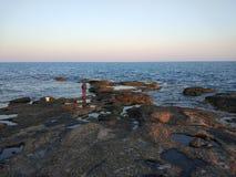 Il pescatore alla spiaggia Fotografia Stock