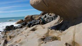 Il photograper in spiaggia di Cothach Immagine Stock