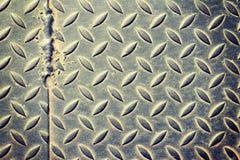 Il piatto del diamante del metallo di danno Fotografie Stock