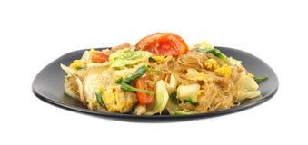 Il piatto di scalpore ha fritto le tagliatelle del fagiolo verde e delle verdure Immagini Stock