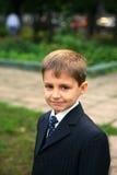 Il piccolo allievo va al banco Fotografia Stock Libera da Diritti