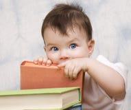 Il piccolo bambino con i libri Immagine Stock Libera da Diritti