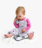 Il piccolo bambino con il telefono Immagini Stock Libere da Diritti