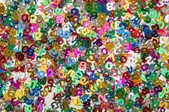 Il piccolo colore numera il fondo dei coriandoli Fotografia Stock Libera da Diritti