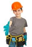 Il piccolo ragazzo dell'operaio dà la scossa della mano Immagine Stock