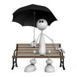 Il piccolo uomo con un ombrello Immagine Stock