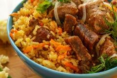 Il pilaf è un piatto tradizionale dell'Asia Immagine Stock