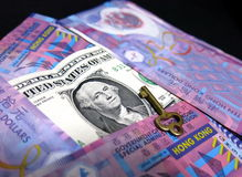 Il piolo del dollaro di Hong Kong al dollaro americano Immagine Stock Libera da Diritti