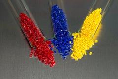 Il polimero granula in prova-vetri Fotografia Stock