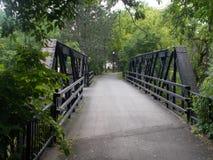 Il ponte alla passeggiata dell'insenatura Immagine Stock