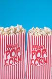 Il popcorn, ottiene il vostro popcorn Fotografia Stock