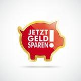Il porcellino salvadanaio dorato Jetzt castra Sparen Fotografie Stock Libere da Diritti