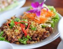Il porco tailandese dell'alimento ha fritto con aglio squisito Fotografia Stock Libera da Diritti