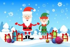 Il presente sorridente di festa di Santa Claus And Christmas Elf With inscatola il buon anno Immagine Stock