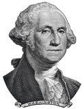 Il Presidente degli Stati Uniti George Washington affronta su una macro della banconota in dollari di U.S.A. immagine stock