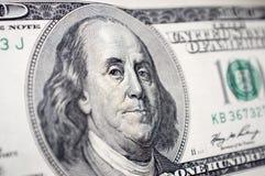 Il primo piano del fronte di Benjamin Franklin sulla banconota in dollari 100 Fotografie Stock Libere da Diritti