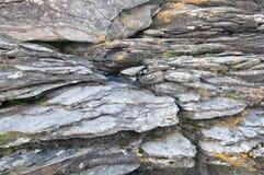 Il primo piano della spiaggia di pietra Immagine Stock
