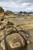 Il primo piano dello speciale ha eroso le rocce ed il terreno in Keelung Immagini Stock