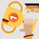 Il primo premio del vincitore sulla mano con la bandiera della Germania illustrazione vettoriale