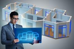 Il progettista che lavora alla progettazione futuristica dell'appartamento 3d Fotografie Stock