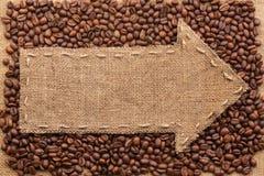 Il puntatore di tela da imballaggio con il posto per il vostro testo, trovantesi su un caffè è Fotografie Stock Libere da Diritti