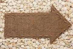 Il puntatore di tela da imballaggio si trova sui semi di girasole Fotografie Stock Libere da Diritti