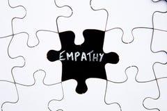 Il puzzle collega - con l'empatia di parola nello spazio mancante Fotografia Stock Libera da Diritti