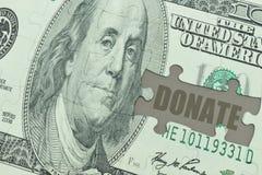 Il puzzle con la banconota del dollaro ed il testo donano Fotografia Stock