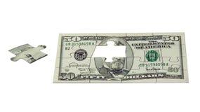 Il puzzle di soldi Fotografia Stock