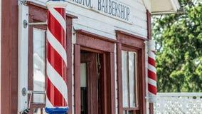 Il racconto di un barbiere nella storia fotografia stock
